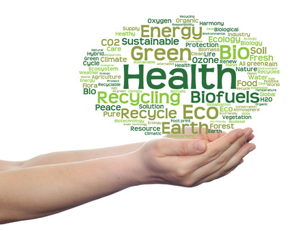 Conceptual ecology word cloud in hands isolated on background