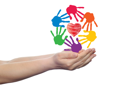 Conceptual circle or spiral made of painted human hands with red heart love or health symbol