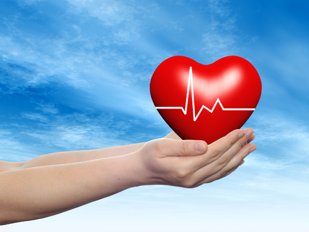 3D conceptual heart with pulse held in hands for health designs over sky Stock Photo