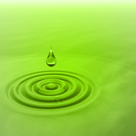 Conceptual green liquid drop falling in water with ripples and waves background Imagens