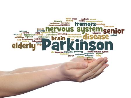 概念または概念パーキンソン病医療や神経系疾患の単語の雲が分離された手で開催されました。