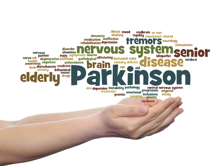 Concept or conceptual Parkinson`s disease healthcare or nervous system disorder word cloud held in hands isolated Banco de Imagens