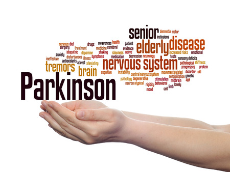 Concept or conceptual Parkinson`s disease healthcare or nervous system disorder word cloud held in hands isolated Stock Photo