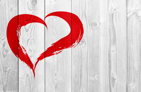 painted wood: Conceptual painted red abstract heart shape love symbol made by happy child at school, old vintage wood background