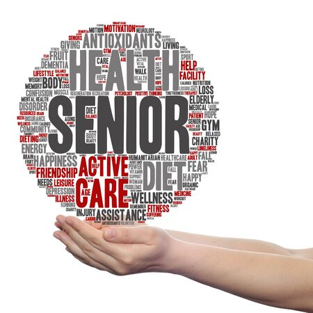 Concept or conceptual old senior health, care or elderly people word cloud held in hands isolated Stock Photo