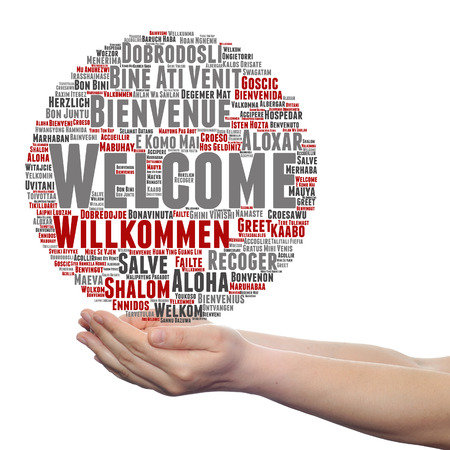 multilingual: Concept or conceptual welcome or greeting international word cloud in hand, multilingual isolated Stock Photo