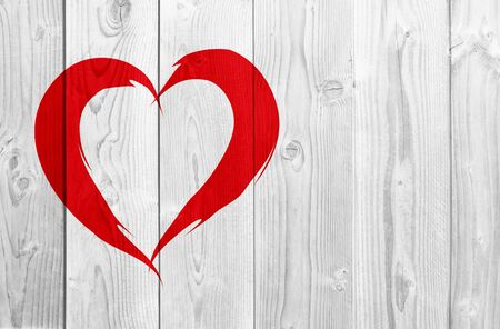 background texture metaphor: Conceptual painted red abstract heart shape love symbol made by happy child at school, old vintage wood background
