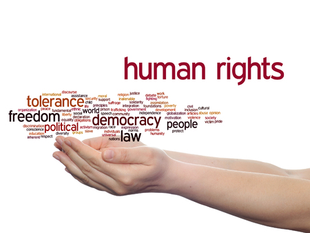 Concept or conceptual human rights political freedom or democracy word cloud in hand isolated on background