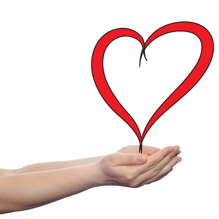 Conceptual painted red heart shape love symbol made by happy child at school, held in human man or woman hand isolated on background