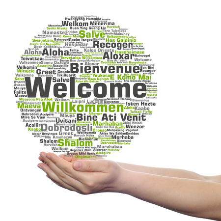 Concept or conceptual welcome or greeting international word cloud in hand, multilingual isolated Stok Fotoğraf