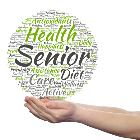 Concept or conceptual old senior health, care or elderly people word cloud held in hands isolated