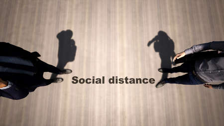 Concept or conceptual 3d illustration of two men meeting following social distance guidelines on a wooden floor background. A metaphor for the change in company relations during the lockdown.