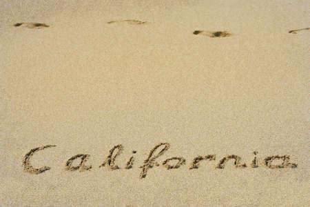 California handwritten in sand for natural, symbol,tourism or conceptual designs Standard-Bild