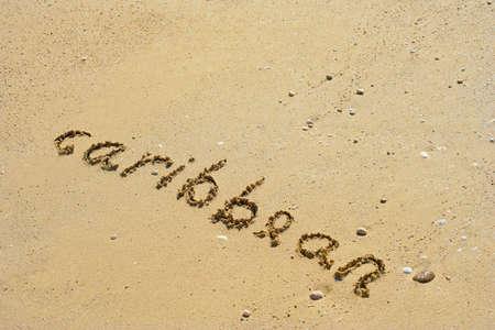 Caribbean handwritten in sand for natural, symbol,tourism or conceptual designs Standard-Bild