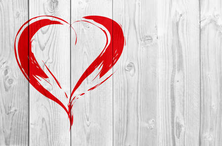 Concept or conceptual painted red abstract heart shape love symbol made by happy child at school, old vintage wood background, metaphor to valentine, romantic, education, romance, happy, art feeling Banco de Imagens - 155343049