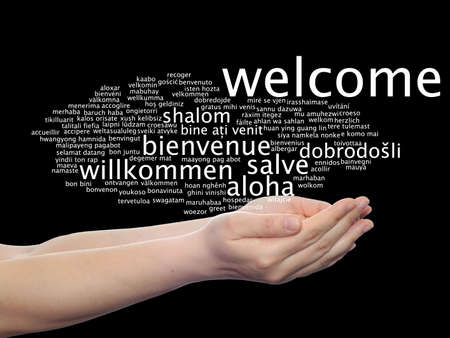 Concept or conceptual abstract welcome or greeting international word cloud in hand, different languages or multilingual, metaphor to world, foreign, worldwide, travel, translate, vacation or tourism Banco de Imagens - 156191457