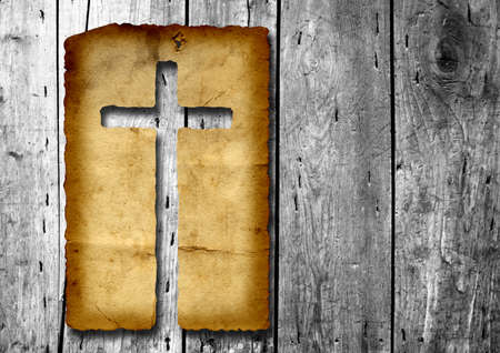 Vintage old grungy paper with a Christian religious cross over ancient wood background ideal for religion, Christian, grunge or conceptual designs Banco de Imagens - 155960291