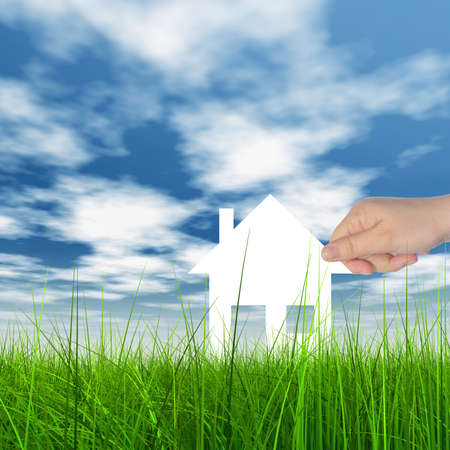 Concept or conceptual white paper house held in hand by a man in a green summer grass over a blue sky background with clouds, a symbol for construction, eco, ecology, loan, mortgage, property or home Banco de Imagens - 156326305