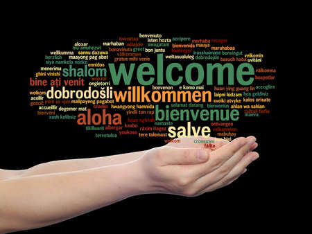 Concept or conceptual abstract welcome or greeting international word cloud in hand, different languages or multilingual, metaphor to world, foreign, worldwide, travel, translate, vacation or tourism Banco de Imagens - 156326316