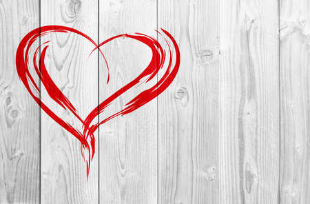 Concept or conceptual painted red abstract heart shape love symbol made by happy child at school, old vintage wood background, metaphor to valentine, romantic, education, romance, happy, art feeling