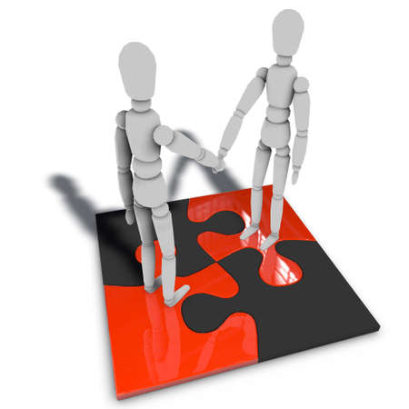 public relation: two figures are standing on a puzzle and shaking hands Stock Photo