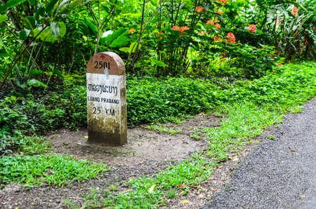 milestone: 25 kilometers to Luangprabang Milestone.