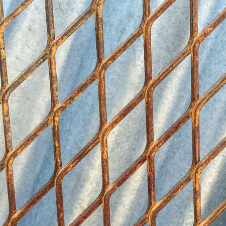 metal mesh: Old Metal mesh fence against zinc background Stock Photo