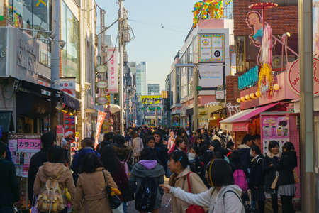 Harajuku: Tokyo, Japan - January 26, 2016: Crowds walk through Takeshita Street in the Harajuku . Tokyo , Japan Editorial
