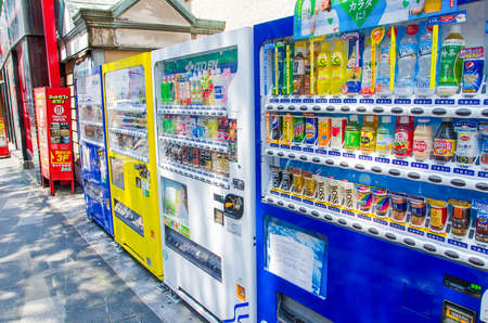 capita: Fukuoka, Japan - June 29, 2014:Vending machines in Fukuoka.apan has the highest number of vending machine per capita in the world at about one to twenty three people.