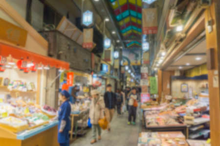 Blurred background. People shopping in Nishiki ichiba market. Nishiki ichiba market is a famous market in Kyoto, Japa Фото со стока