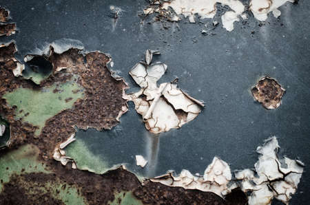 corroded: Corroded and peeled metal with rust texture