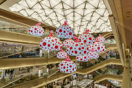 TOKYO , JAPAN - July 26, 2017 : Models of pumpkins by Kusama Yayoi hang from the ceiling of Ginzasix shopping center.