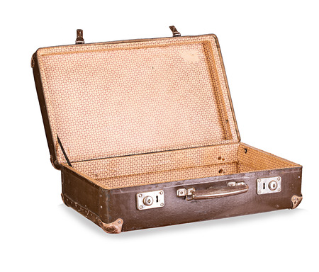 白い背景に分離された古いスーツケース クローズ アップ