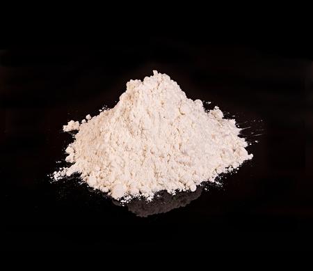 heroin: Drug powder close-up on a black background.