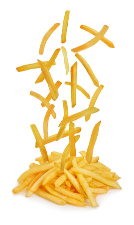 Flying fried potatoes isolated on white background. French fries. Fast food .