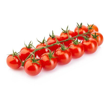 白い背景に分離された枝に熟した新鮮なチェリー トマト。