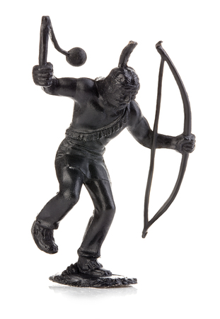 swarty: North American indian with mace and bow close-up isolated on white . Miniature figurine of a childrens toy.