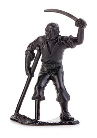 legless: Angry pirate legless on crutches with a saber. Miniature figurine of a childrens toy.