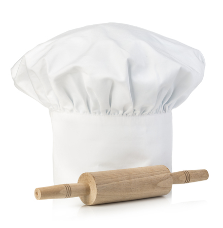 rollingpin: Original cooks cap with wooden rolling-pin. Chefs hat close-up isolated on a white background.