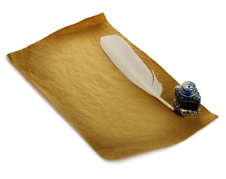 inkwell: White feather, inkwell on an old brown paper sheet close-up isolated. Retro style. Stock Photo