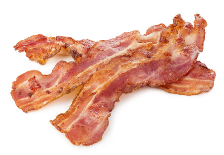 Cooked bacon rashers close-up isolated on a white background. Imagens - 51746366