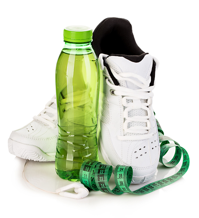 water shoes: Fitness concept. Weight loss concept close-up isolated on a white background. Stock Photo
