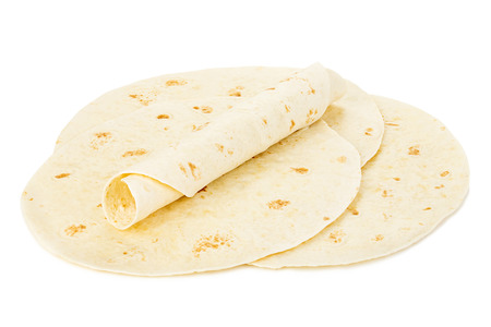 Round wheat tortillas close-up isolated on white background. Lavash. Imagens