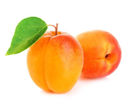 Fresh apricots with leaf close-up isolated on a white background.