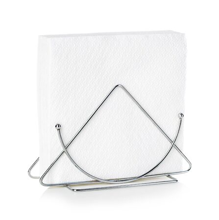 Napkins in metal stand close-up isolated on a white background. Reklamní fotografie
