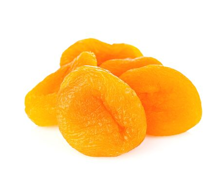 Dried apricots close-up isolated on a white background.