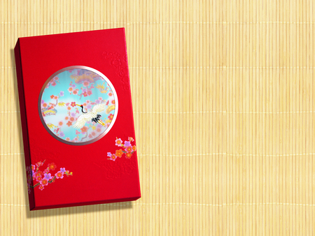 Red premium Chinese gift box for Chinese New Year, Anniversary, Mid-Autumn Festival, Valentine's Day, Birthday. On bamboo background. 스톡 콘텐츠