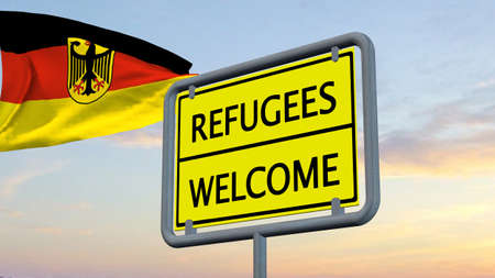 humane: Refugees welcome sign in front of Germany flag Stock Photo