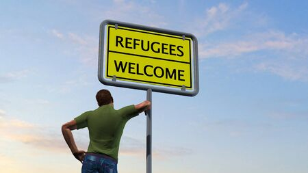 refugees: Man next Refugees welcome sign