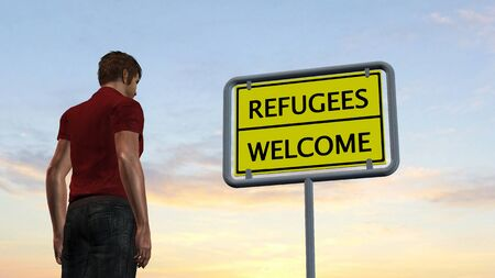 humane: young man in front of Refugees Welcome Sign